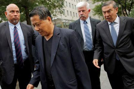 Macau real estate developer Ng Lap Seng (2nd L), accused of bribing former United Nations General Assembly president John Ashe, exits U.S Federal Court in the Manhattan borough of New York, U.S., June 27, 2016.  REUTERS/Andrew Kelly