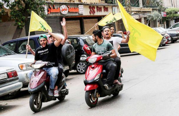 PHOTO: Supporter of Hezbollah carry their party flags and ride motorcycles at the southern suburb of Beirut, Lebanon, May 06, 2018. (Nabil Mounzer/EPA via Shutterstock)