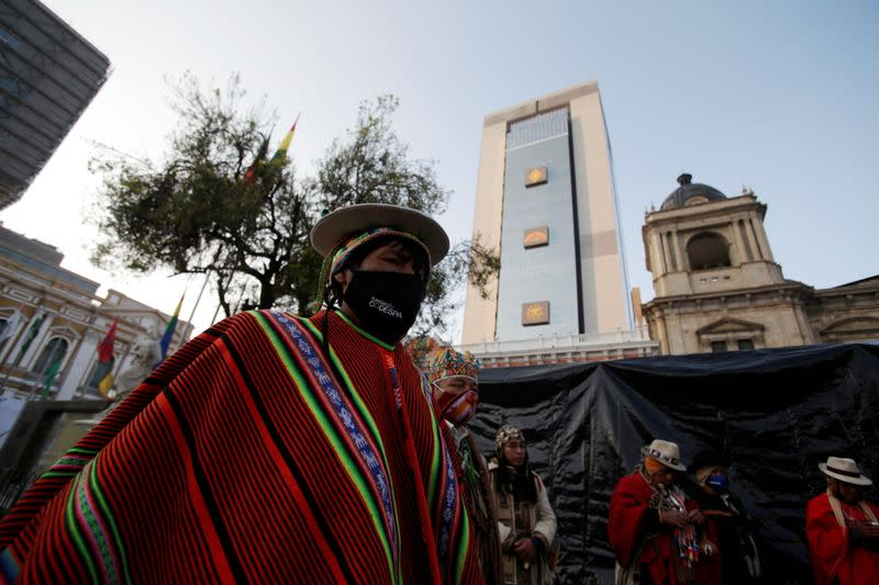 Aymara witchdoctors make an offering before the swearing-in ceremony of Bolivia's President-elect Luis Arce at the Plaza Murillo, in La Paz