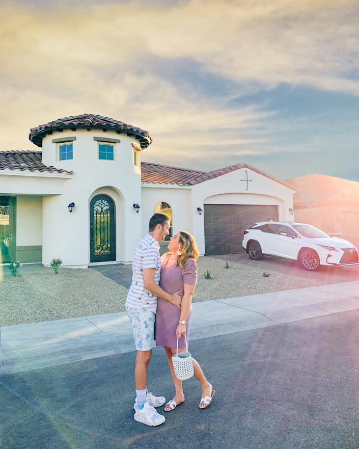 Fashion blogger Sarah Tripp and her husband, Robbie Tripp, lived in San Francisco for two years before deciding their money would go a lot farther somewhere else. Here they stand in front of the new home they purchased in Phoenix, where they plan to raise their newborn son.