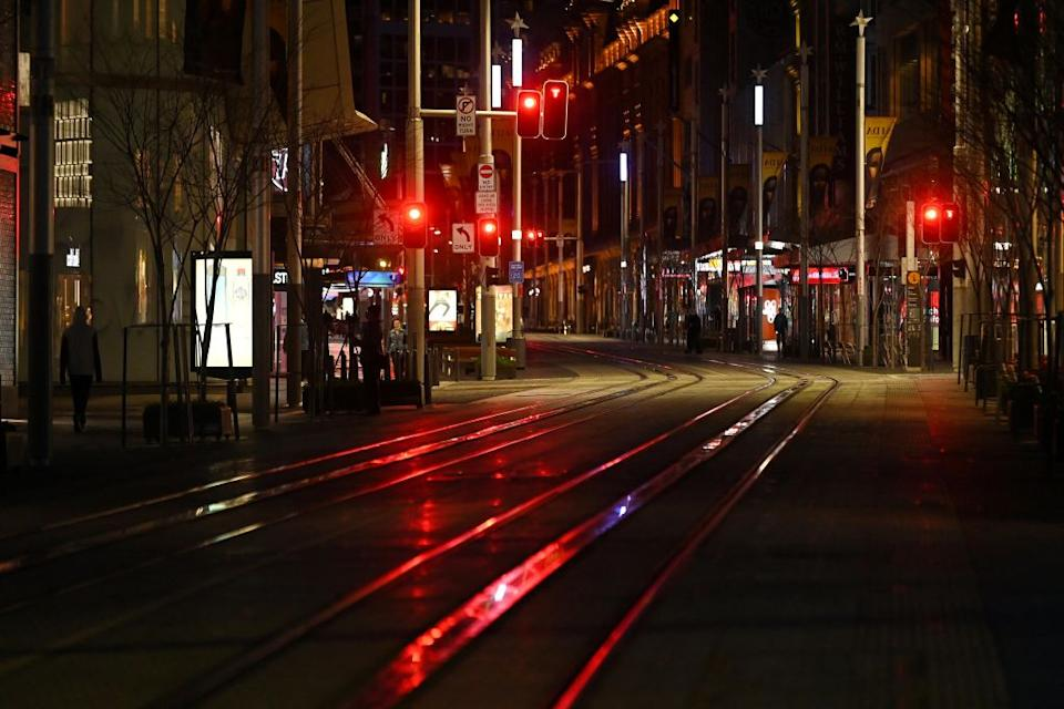 A quiet George Street promenade is pictured on a usually busy evening in Sydney after authorities ordered new restrictions as a weeks-long lockdown failed to quash an outbreak of the Covid-19 coronavirus.