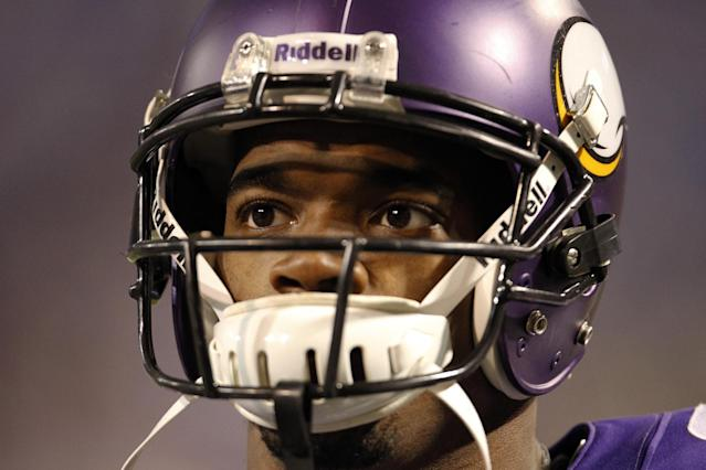 Minnesota Vikings running back Adrian Peterson warms up before an NFL football game against the Green Bay Packers, Sunday, Oct. 27, 2013, in Minneapolis. (AP Photo/Ann Heisenfelt)
