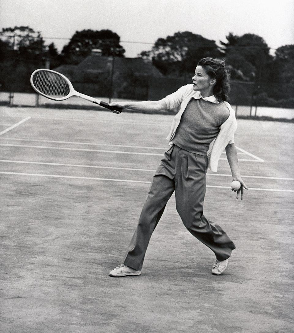 Katharine Hepburn, screen and stage star, returns a drive during a friendly game of tennis at the Merion Cricket Club in Philadelphia, 1940.