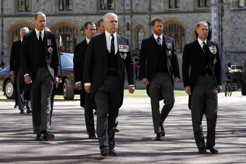 The royal family walking behind Prince Philip's coffin