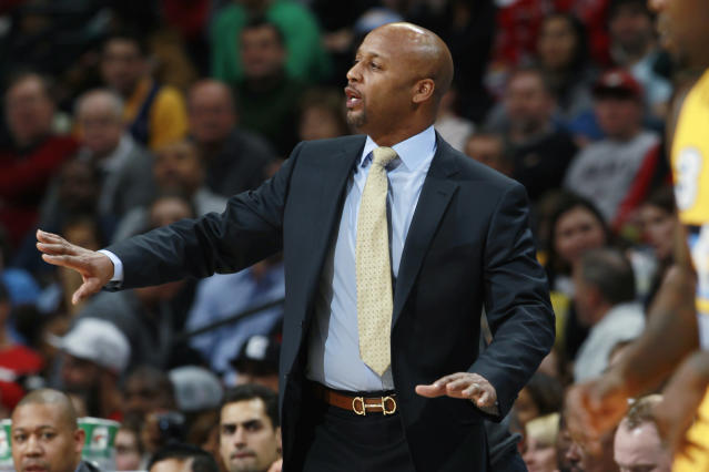 Denver Nuggets head coach Brian Shaw directs his team against the Miami Heat in the first quarter of an NBA basketball game in Denver on Monday, Dec. 30, 2013. (AP Photo/David Zalubowski)