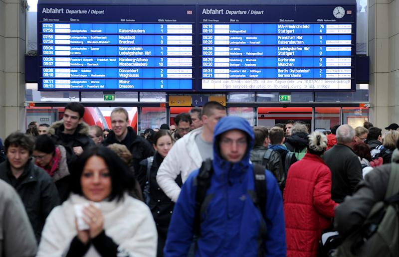Passengers  gather in the hall  of Mannheim, train station Thursday, March 10, 2011. German train drivers left thousands of commuters stranded across the country Thursday morning with a rush-hour strike aimed at pressuring the state-owned national railway and smaller, private operators for higher pay.  Some 800 drivers walked off the job between 4 a.m. and 10 a.m. Thursday, halting hundreds of commuter, long-distance and regional trains the nation's main cities, including Berlin, Hanover,  Munich, Frankfurt and Stuttgart. The GDL union is demanding a collective pay agreement for drivers at the national railway operator, Deutsche Bahn, and its private competitors that run trains on some routes and tend to pay lower wages. (AP Photo/dapd/Thomas Lohnes)
