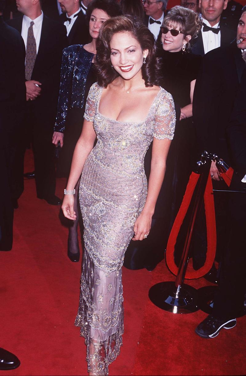Lopez started receiving critical attention with her performance in Selena, for which she was nominated for a Golden Globe. She appeared at her first Oscars later that year n a sparkly lace gown, looking every inch the movie star she would soon before. They say dress the part, after all. Jennifer Lopez in Badgely Mischka at the 69th annual Academy Awards in Los Angeles, California, March 1997. Photo by Getty Images.