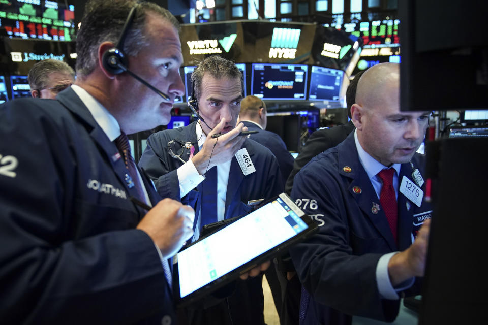 NEW YORK, NY - AUGUST 6: Traders and financial professionals work at the opening bell on the floor of the New York Stock Exchange (NYSE) on August 6, 2019 in the Brooklyn borough of  New York City. The Dow Jones Industrial Average traded 220 points higher at the open on Tuesday, after U.S. markets had their worst trading day of 2019 on Monday amid escalations in the U.S.-China trade war. (Photo by Drew Angerer/Getty Images)