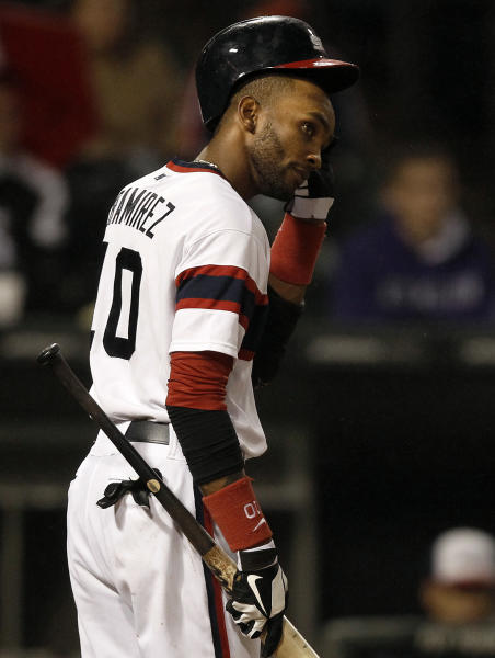 Chicago White Sox's Alexei Ramirez removes his helmet after striking out swinging during the sixth inning of a baseball game against the Cleveland Indians, Sunday, Sept. 15, 2013, in Chicago. (AP Photo/Andrew A. Nelles)