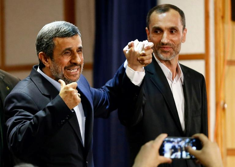 Former Iranian president Mahmoud Ahmadinejad stands with former Iranian vice president Hamid Baghaei after registering at the interior ministry's election headquarters on April 12, 2017, as candidates sign up for the upcoming presidential elections