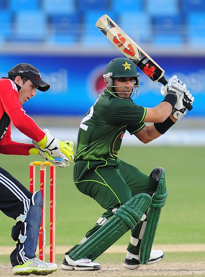 Pakistan's captain Misbah-ul-Haq (R) plays a shot as England's wicketkeeper Craig Kieswetter (L) watches during the fourth and final One Day International (ODI) match between Pakistan and England at the Dubai International cricket Stadium in Dubai Sports City on February 21, 2012. Flu and injury-hit Pakistan won the toss and chose to bat in the fourth and final one-day against England at Dubai Stadium here on Tuesday. AFP PHOTO/ LAKRUWAN WANNIARACHCHI (Photo credit should read -/AFP/Getty Images)