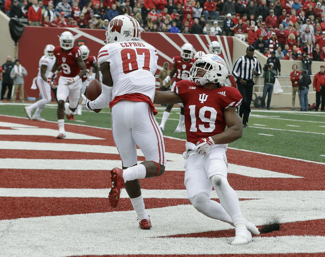 "Wisconsin wide receiver <a class=""link rapid-noclick-resp"" href=""/ncaaf/players/268270/"" data-ylk=""slk:Quintez Cephus"">Quintez Cephus</a> (87) makes an eight yard touchdown reception against Indiana's <a class=""link rapid-noclick-resp"" href=""/ncaaf/players/244396/"" data-ylk=""slk:Tony Fields"">Tony Fields</a> (19) during the first half of an NCAA college football game, Saturday, Nov. 4, 2017, in Bloomington, Ind. (AP Photo/Darron Cummings)"
