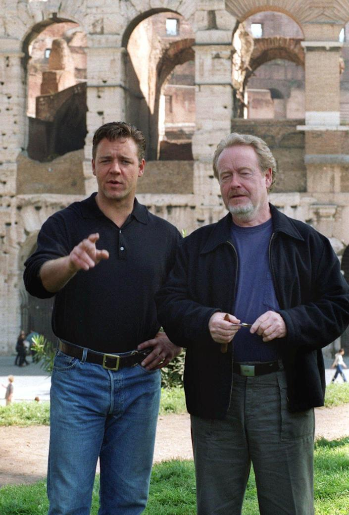 """**FILE**Director Ridley Scott, right, and actor Russell Crowe pose in front of Rome's Colosseum to promote the Italian premiere of the film """"Gladiator"""" in Rome, on April 26, 2000. (AP Photo/Corrado Giambalvo)"""