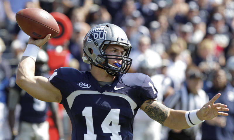 FILE - In this Sept. 22, 2012, file photo, Old Dominion quaterback Taylor Heinicke throws a pass against New Hampshire during an NCAA college football game in Norfolk, Va. Heinicke, the record-setting quarterback from Old Dominion, and Eric Breitenstein, the 2,000-yard rusher from Wofford, have been selected to The Associated Press FCS All-America football team on Wednesday, Dec. 12, 2012. (AP Photo/The Virginian-Pilot, Steve Earley) MAGS OUT