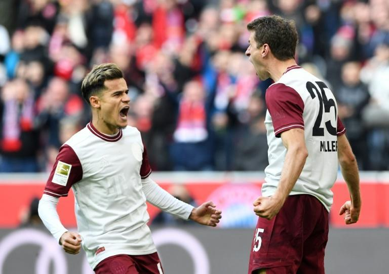Can Bayern Munich see off the chasing pack to claim an eighth straight title as the Bundesliga returns behind closed doors? (AFP Photo/Christof STACHE)