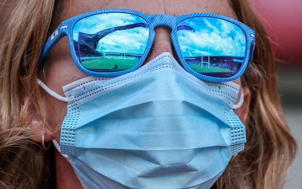 Those experiencing eye discomfort should ensure their mask fits firmly around the nose, so air is forced out at the sides - Fred Scheiber/AFP