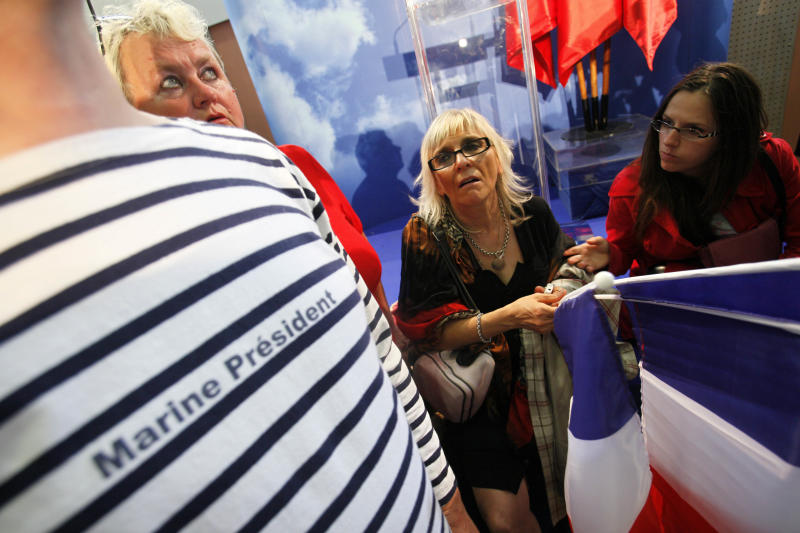Supporters of France's National Front Party react after the second round of the French legislative elections, Sunday, June 17, 2012 in Henin-Beaumont, northern France where far-right leader Marine Le Pen has lost her race for a parliamentary seat, but her anti-immigrant National Front party will have its first seats in parliament in years. French Legislative elections determine the makeup of the new parliament. (AP Photo/Michel Spingler)