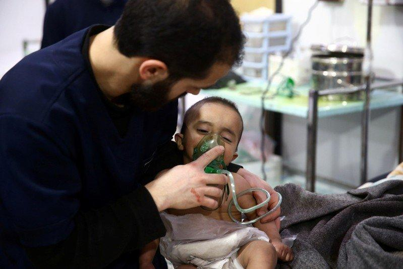 Man with a child are seen in hospital in the besieged town of Douma Eastern Ghouta Damascus Syria