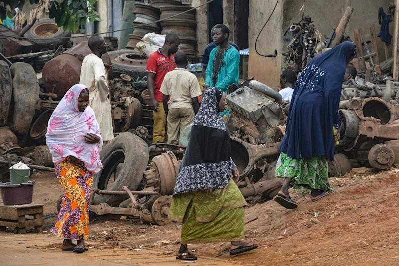 Muslim women walk in the Brituetterie district of Yaounde on July 16, 2015, a northern region of Cameroon, which has suffered frequent attacks by the jihadist Boko Haram group (AFP Photo/Reinnier Kaze)