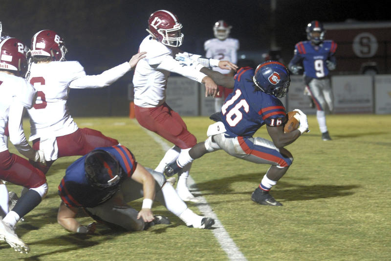 In this photo provided by Mike Pettus, Central of Clay County High School's Quentin Knight (16) scores against Sardis High School during a football game in Lineville, Ala., Friday, Nov. 8, 2019. At Central of Clay County High School in Alabama, small-town football is thriving. The team has helped bond two communities that were once fierce rivals, then reluctant partners, and now proud supporters of a two-time Class 5A state football champions. (Mike Pettus via AP)