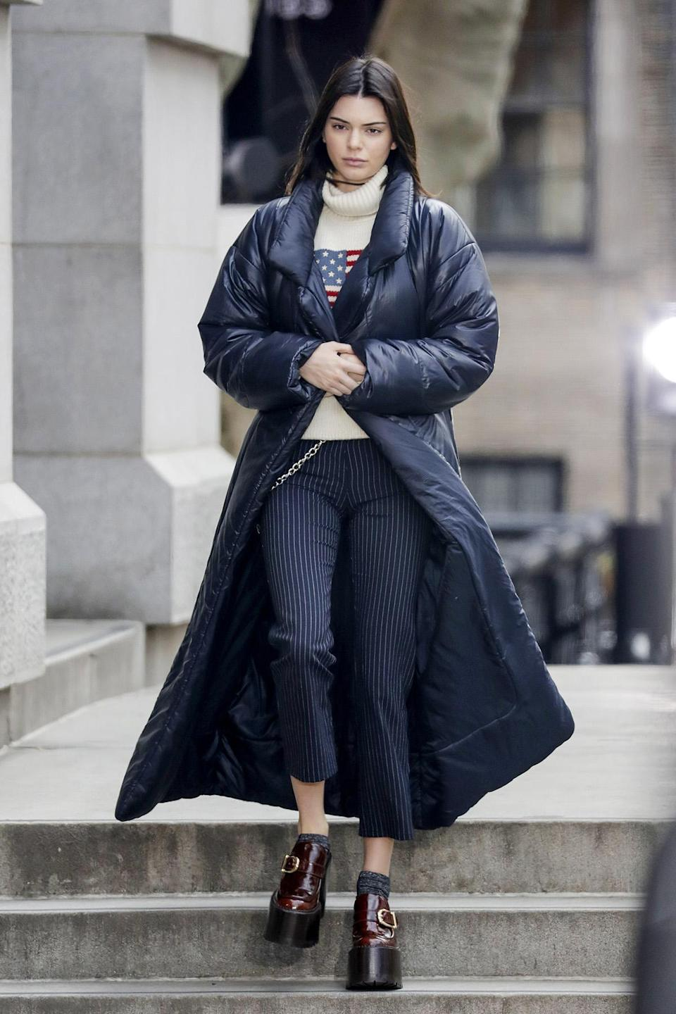 <p>Kendall Jenner was spotted in her cropped pinstripe Miaou jeans after walking in the Marc Jacobs show during NYFW in February 2017. (Photo: AKM-GSI) </p>