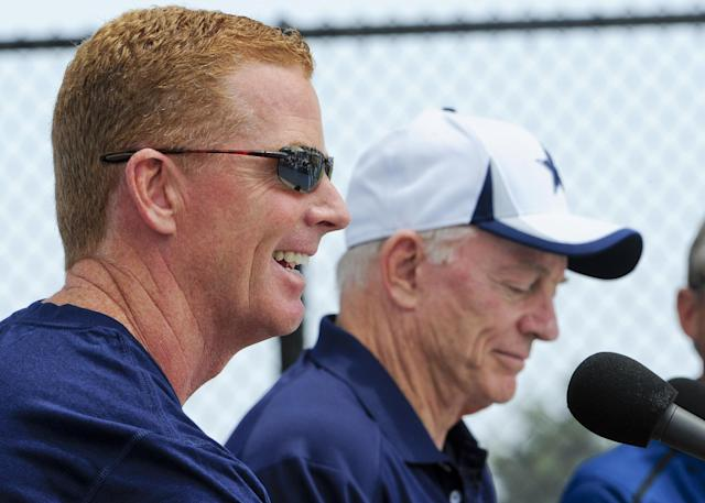Dallas Cowboy head coach Jason Garrett, front left, and owner Jerry Jones, right, address the press during the state of the Cowboys address at Dallas Cowboy's training camp, Saturday, July 20, 2013, in Oxnard, Calif. (AP Photo/Gus Ruelas)