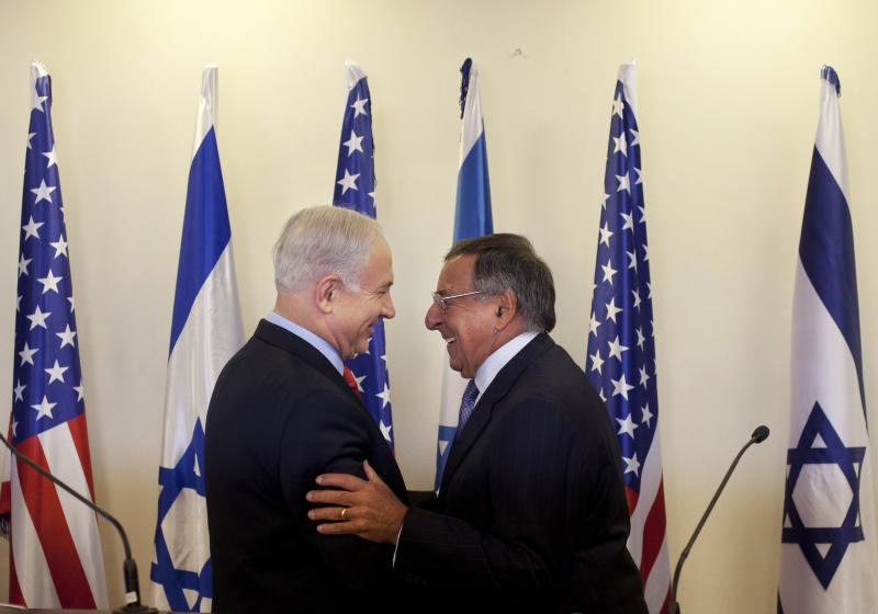 Israeli Prime Minister Benjamin Netanyahu, left, and U.S. Defense Secretary Leon Panetta shake hands during a meeting at the Prime Minister's office in Jerusalem, Wednesday, Aug. 1, 2012. Israel's threats to attack Iran and the violence convulsing Syria top the agenda of Panetta's meetings Wednesday with Israeli government leaders. (AP Photo/Sebastian Scheiner, Pool)