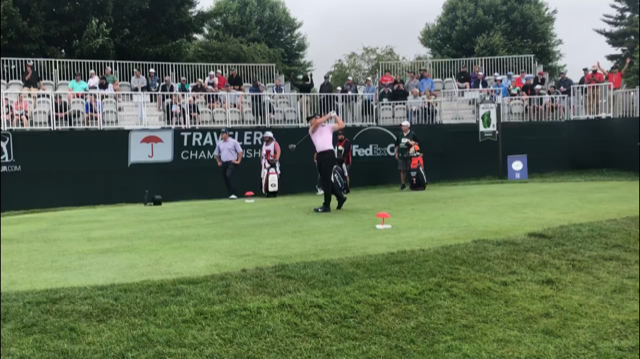 "<div class=""caption""> Matthew Wolff hits his first shot as a pro at the 2019 Travelers Championship. </div>"