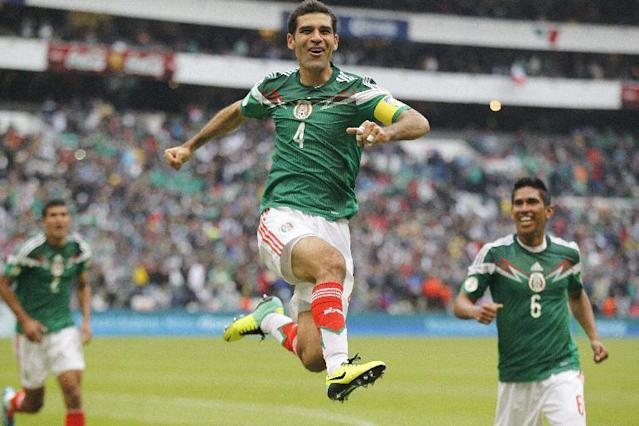 In this Wednesday, Nov. 13, 2013 photo, Mexico's Rafael Marquez celebrates after scoring his team's 5th goal during a 2014 World Cup playoff first round match against New Zealand in Mexico City. Mexico beat New Zealand 5-1 on Wednesday in the first leg of their intercontinental playoff to close in on a spot in the World Cup next year. (AP Photo/Eduardo Verdugo)