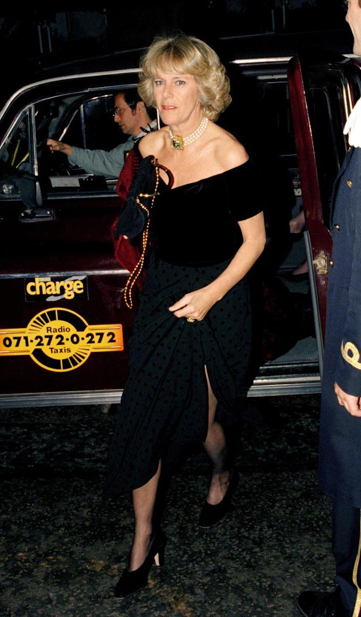 <p>Back when Camilla and Charles were still dating, the couple attended a party together at the Ritz in London. For the occasion, Camilla chose a black off-the-shoulder dress with a subtle polkadot pattern pleated skirt as well as a three strand pearl choker—a style that would become a jewelry signature for her. </p>
