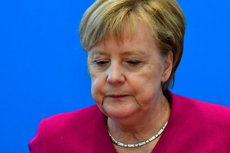German Chancellor Angela Merkel has headed the CDU for 18 years