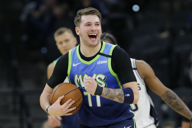 Dallas Mavericks guard Luka Doncic (77) reacts to a play during the second half of an NBA basketball game against the San Antonio Spurs in San Antonio, Wednesday, Feb. 26, 2020. (AP Photo/Eric Gay)