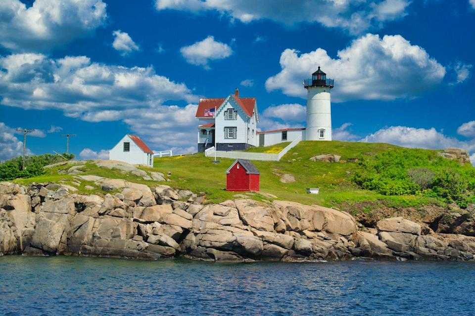 Cape Neddick (Nubble) Light sits on a small rock island known as the Nubble just off the coast of York, Maine.