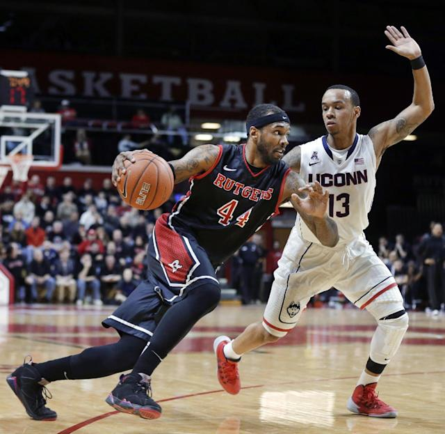 Rutgers forward J.J. Moore (44) dribbles the ball as Connecticut guard Shabazz Napier (13) tries to block his path during the first half of an NCAA college basketball game Saturday, Jan. 25, 2014, in Piscataway, N.J. (AP Photo/Mel Evans)