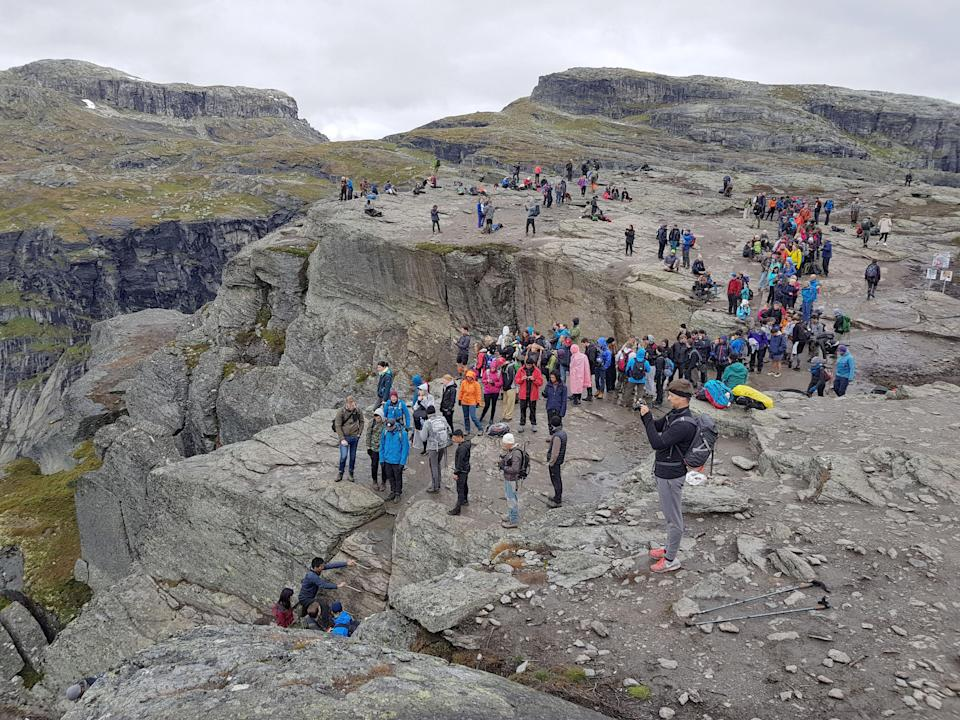 Not so scenic – the queues on the rock (Trolltunga Adventures / Caters News)
