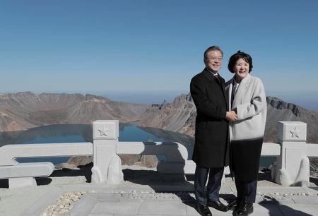 South Korean President Moon Jae-in and first lady Kim Jung-sook pose for photographs on the top of Mt. Paektu, North Korea, September 20, 2018. Pyeongyang Press Corps/Pool via REUTERS