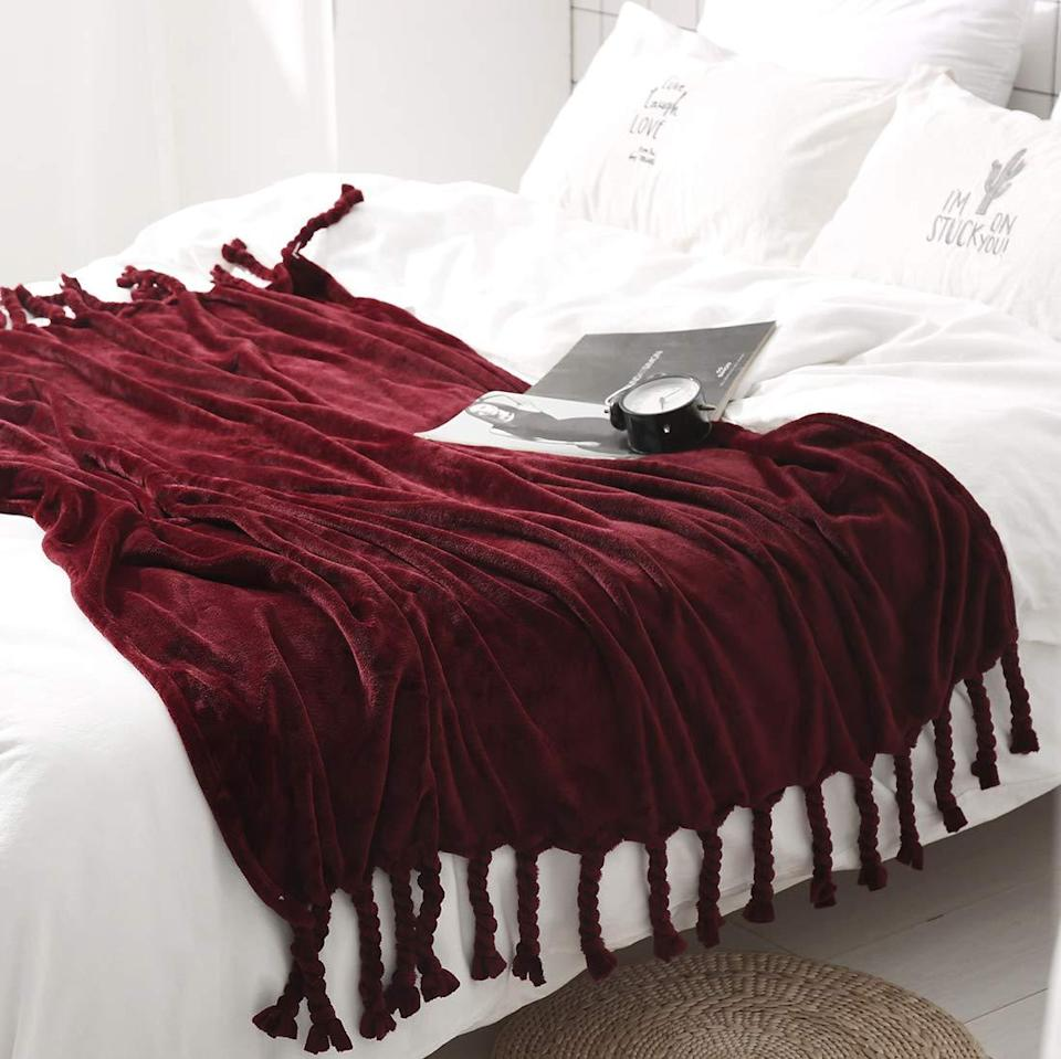 "<h3><a href=""https://amzn.to/33WX7VR"" rel=""nofollow noopener"" target=""_blank"" data-ylk=""slk:Velvet Throw Blanket"" class=""link rapid-noclick-resp"">Velvet Throw Blanket</a> </h3><br>There's no ugly couch on the planet that can't be improved by a good throw — and this velvet style with fringed edges is a cozy-chic holiday essential. <br><br><strong>Homiest</strong> Velvet Throw Blanket, $, available at <a href=""https://amzn.to/33WX7VR"" rel=""nofollow noopener"" target=""_blank"" data-ylk=""slk:Amazon"" class=""link rapid-noclick-resp"">Amazon</a>"