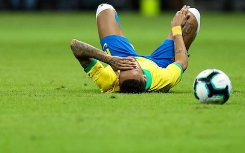 <span>Neymar injured himself during a recent international friendly</span> <span>Credit: GETTY IMAGES </span>
