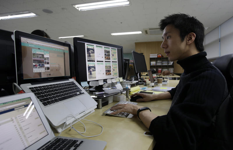 In this Monday, Jan. 20, 2014 photo, Value Creators & Company CEO Park Jaeuk shows his company's app Between on a screen at his office in Seoul, South Korea. Created by the Seoul-based startup, Between hit 5 million downloads in two years. About two thirds of the users are in South Korea with their average age in the mid-20s. Between has attracted more than half a million users in Japan and is expanding in Thailand and Singapore. Hundreds of thousands of Chinese and American couples have also joined. (AP Photo/Lee Jin-man)