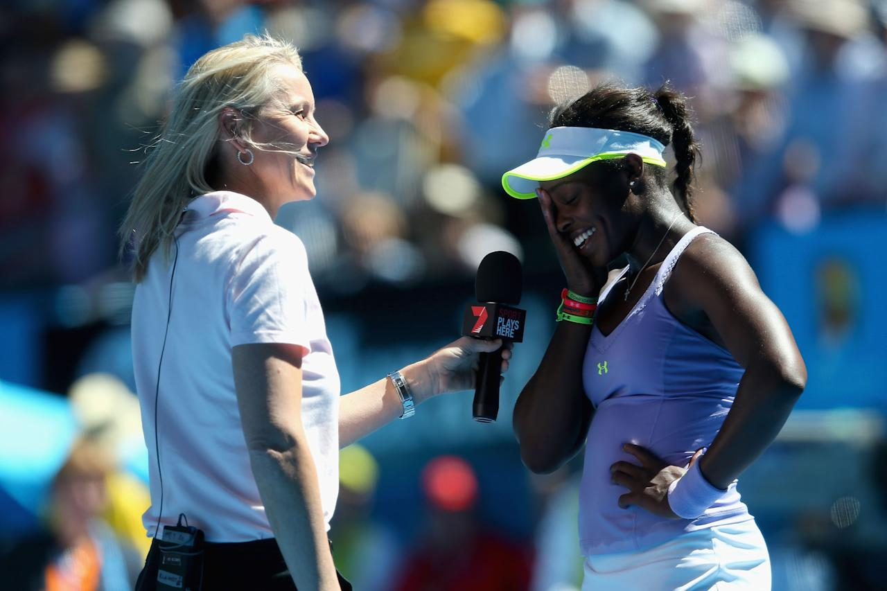 MELBOURNE, AUSTRALIA - JANUARY 23:  Sloane Stephens of the United States celebrates is interviewed after winning her Quarterfinal match against Serena Williams of the United States of America during day ten of the 2013 Australian Open at Melbourne Park on January 23, 2013 in Melbourne, Australia.  (Photo by Julian Finney-Pool/Getty Images)
