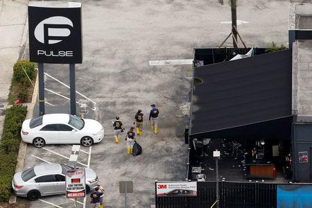 FILE PHOTO - FBI officials walk through Pulse gay night club parking lot in Orlando