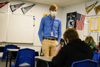 Cooper Hanson, a substitute teacher at the Greenfield Intermediate School in Greenfield, Ind., is photographed Thursday, Dec. 10, 2020. Hanson, a student at Hanover College, is one of several college students being recruited to work as substitute teachers in schools during the pandemic. (AP Photo/Michael Conroy)