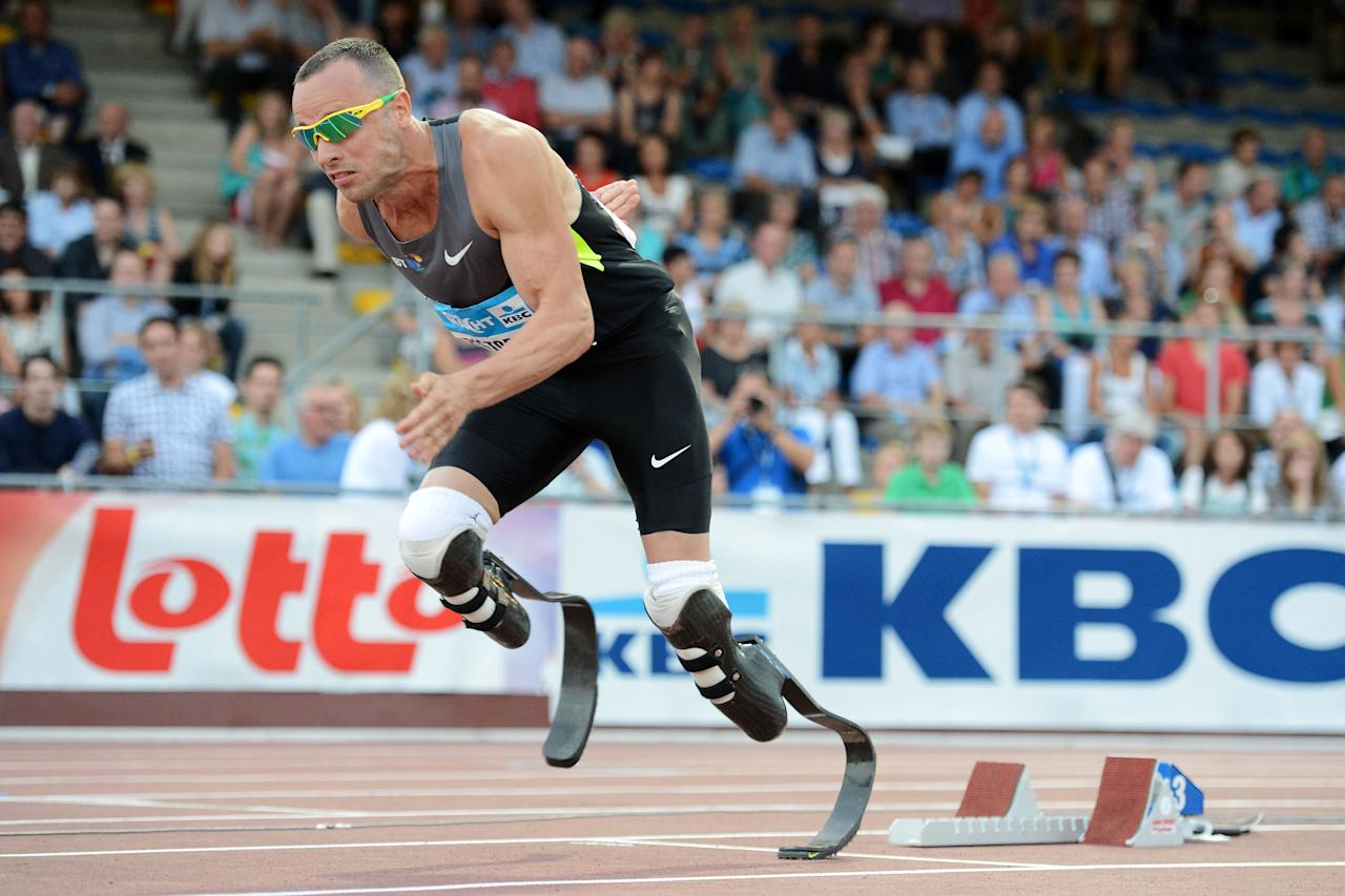 FILE - In this file photo dated Saturday, July 7, 2012, South Africa's Oscar Pistorius competes during the 400m men's event at the KBC Night of Athletics in Heusden, Belgium. The South African double amputee is going to the London 2012 Olympics, re-igniting the fierce debate over the carbon fiber blades he runs on and his right to compete alongside able-bodied athletes. (AP Photo/Geert Vanden Wijngaert, File)