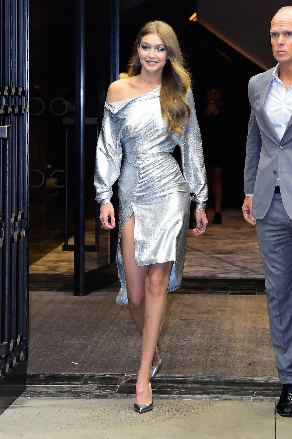 <p>In a metallic off-the-shoulder dress and mirrored heels at the Daily Front Row's Fashion Media Awards in NYC. </p>