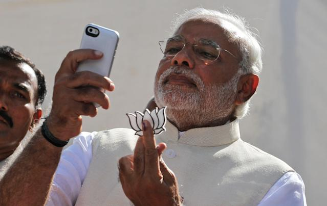 Indian Prime Minister Narendra Modi takes selfie on his mobile
