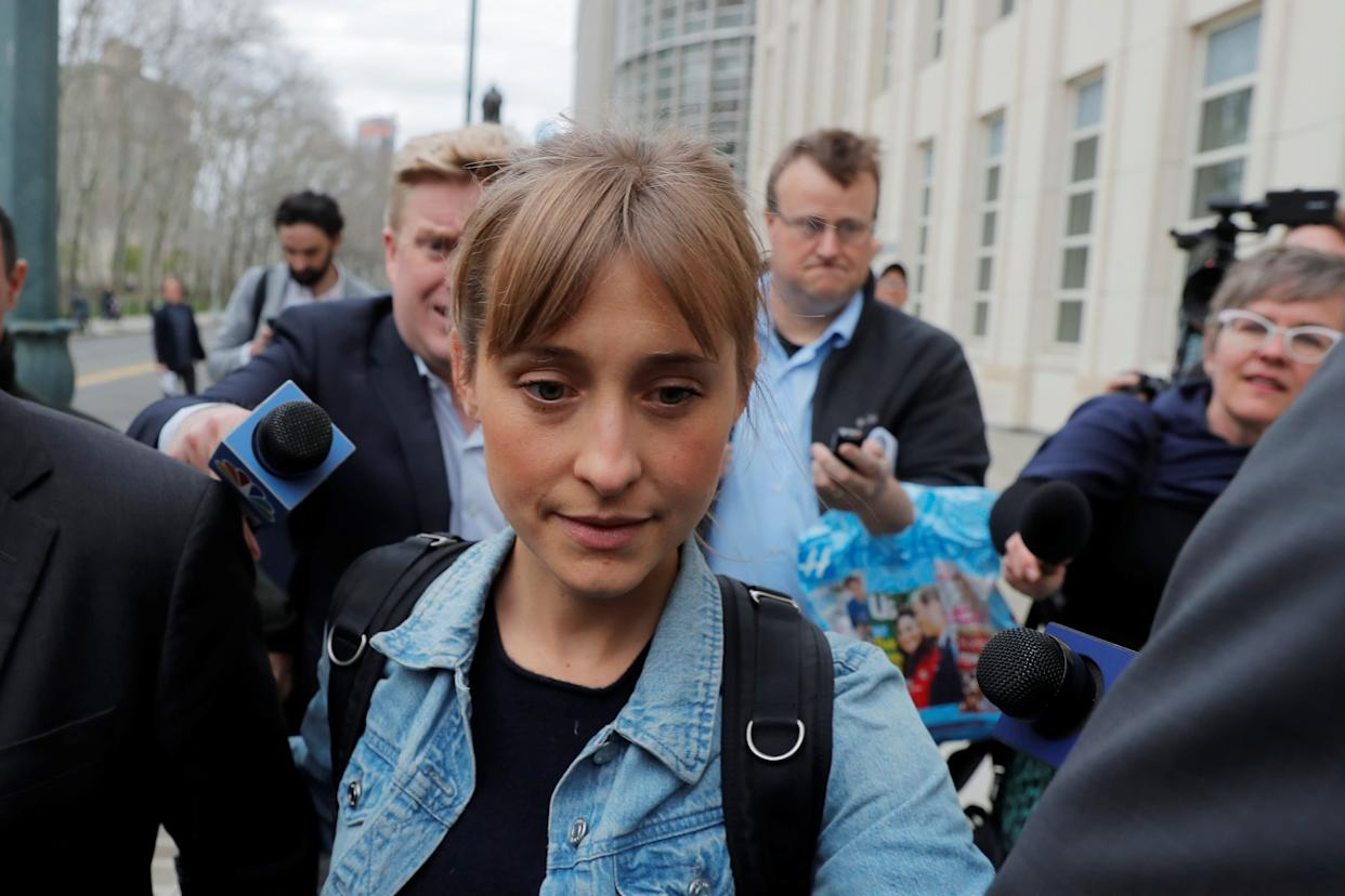 """Actress Allison Mack, known for her role in the TV series """"Smallville"""", departs after being granted bail following being charged with sex trafficking and conspiracy in New York, U.S., April 24, 2018."""