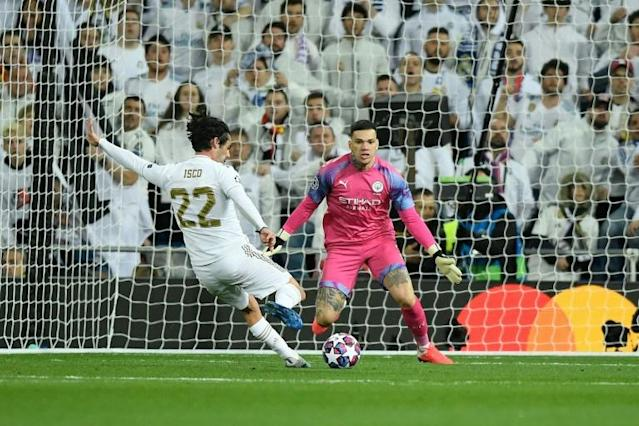 Isco scores the opening goal past Manchester City goalkeeper Ederson (AFP Photo/OSCAR DEL POZO)