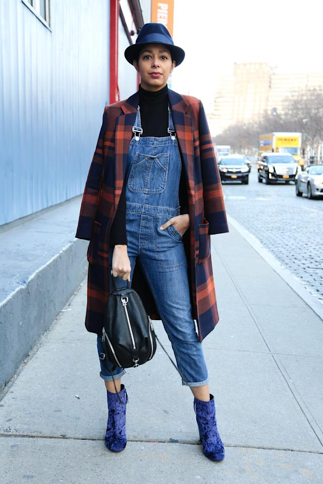 <p>It's easy to make overalls look super chic. Ankle booties and a smart coat layered over the top do the trick.</p>
