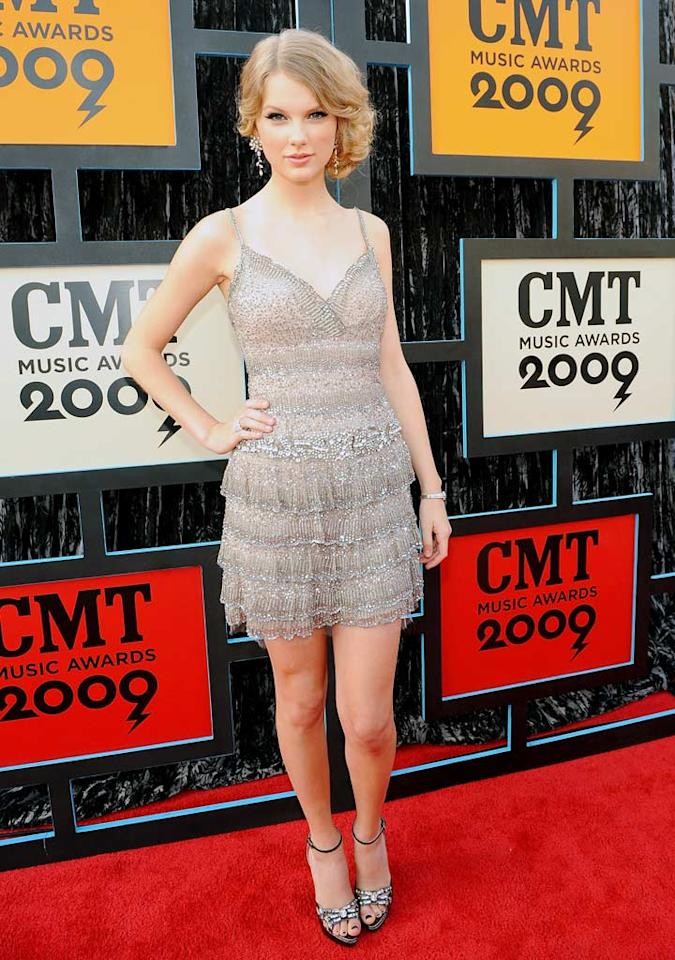"Taylor Swift brought a touch of class to the CMT Music Awards red carpet in her beaded mini dress and sideswept 'do. Rick Diamond/<a href=""http://www.gettyimages.com/"" target=""new"">GettyImages.com</a> - June 16, 2009"