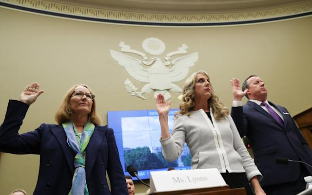 USOC acting chief Susanne Lyons (L), USA Gymnastics CEO Kerry Perry and Tim Hinchey, President and CEO of USA Swimming prepare to testify at a House Energy and Commerce Committee hearing on Olympic athletes and sexual abuse on Capitol Hill in Washington, U.S., May 23, 2018. REUTERS/Jonathan Ernst